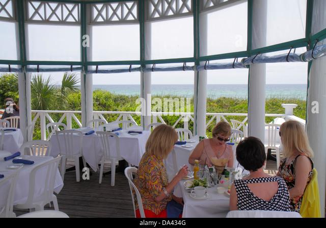 Florida Seaside master-planned community New Urbanism Shrimp Shack restaurant woman gazebo Gulf of Mexico coast - Stock Image
