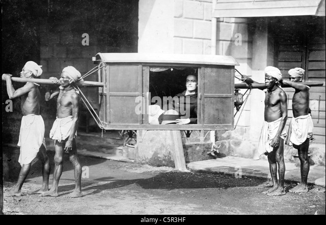 Four Indians carrying palanquin, India - Stock Image