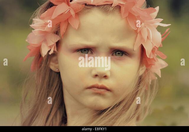 Girl in pink headband - Stock Image