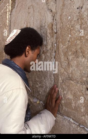 Israel Jerusalem Western Wall Ethiopian male Jew praying holy place religion - Stock Image