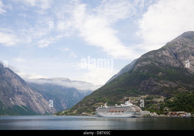 Eidfjord Hordaland Norway Europe Crystal Sympathy cruise ship in harbour of town situated where the Hardangerfjord - Stock Image