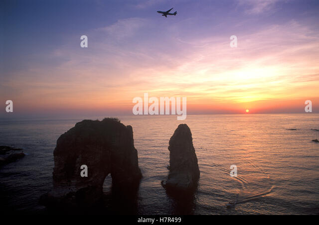Beirut Sunset Over Pigeon Rocks - Stock Image