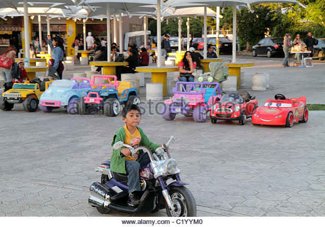 Cancun Mexico Yucatán Peninsula Quintana Roo Parque de las Palapas Hispanic boy woman mother son child rental - Stock Image