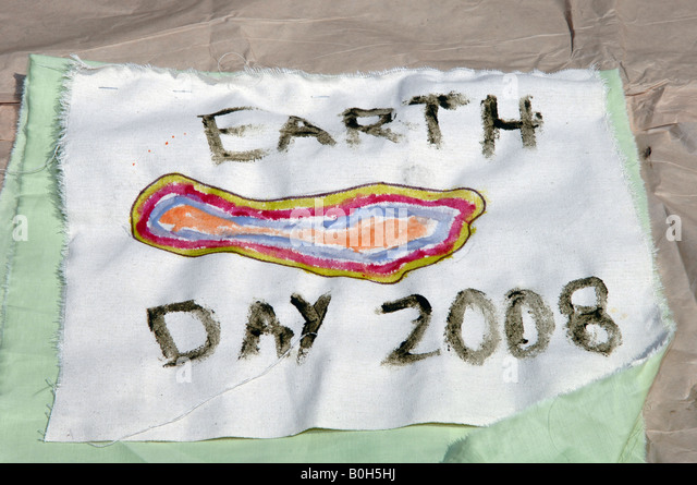 Reduce Your Carbon Footprint Parade Scroll - Stock Image