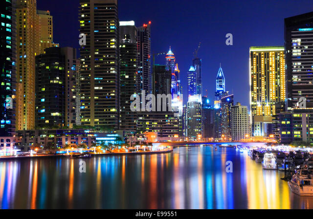 Dubai Marina at night.Reflection of skyscrapers in water. - Stock Image