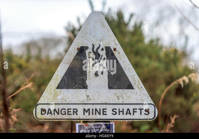 A warning sign in an area near abandoned mine shafts - Stock Image