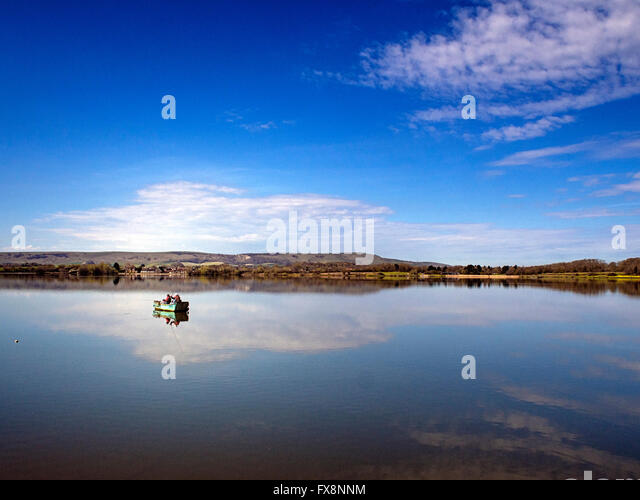 Trout fly fishing from a boat at Arlington Reservoir, near Berwick and the South Downs, East Sussex - Stock Image