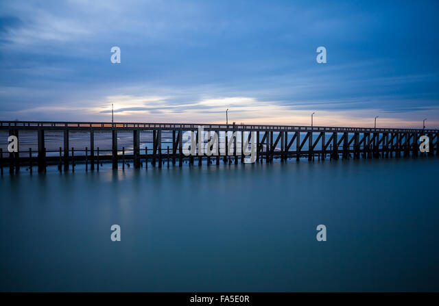 The pier that reaches deep into the sea - Stock-Bilder