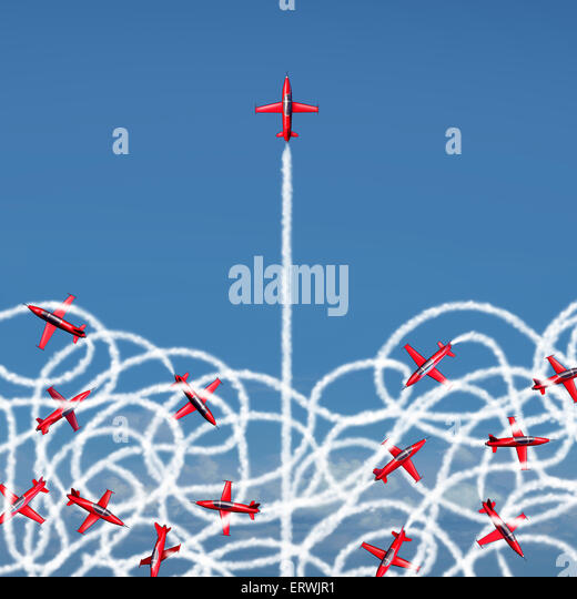 Management leadership concept and managing a crisis as a business symbol with a group of acrobatic jet airplanes - Stock Image