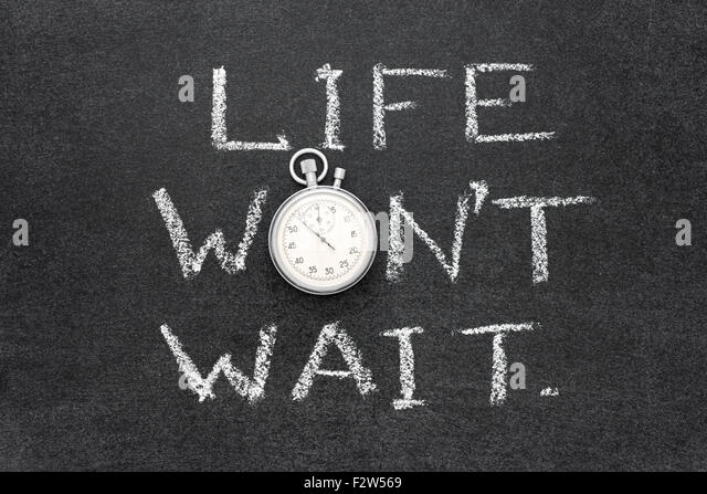 life wont wait phrase handwritten on chalkboard with vintage precise stopwatch used instead of O - Stock Image