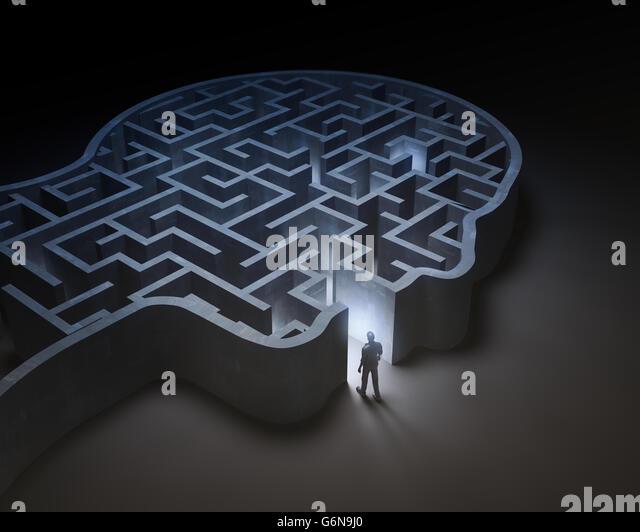 Man entering a maze inside a head - 3D illustration - Stock-Bilder