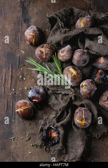 Roasted chestnuts in the ashes - Stock Image