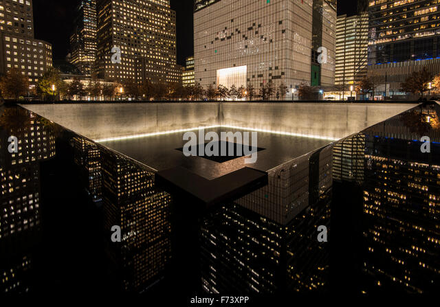 Night view of the Northern Pool, National September 11 Memorial & Museum, Lower Manhattan, New York, USA - Stock Image