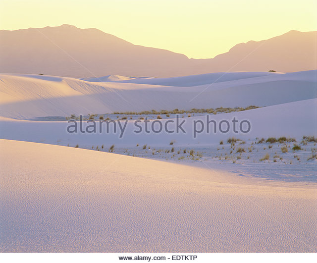 Sunset over gypsum dunes and the San Andres Mountains.  White Sands National Monument, New Mexico - Stock Image