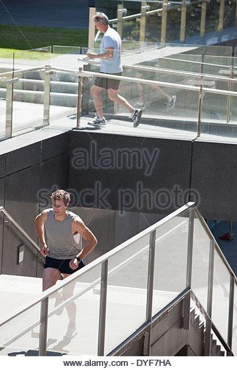 Two men running - Stock Image