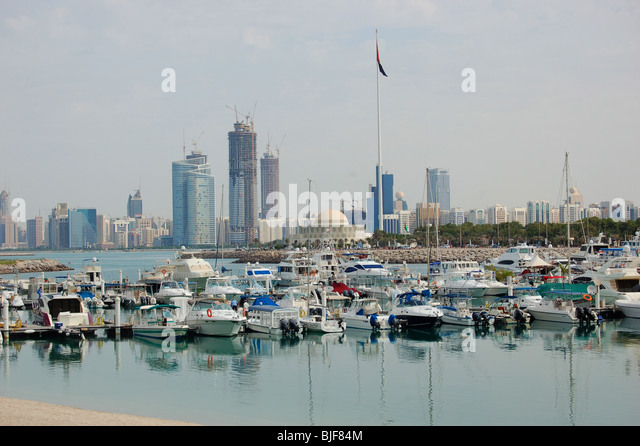 View of Abu Dhabi city and harbour from waterfront - Stock Image
