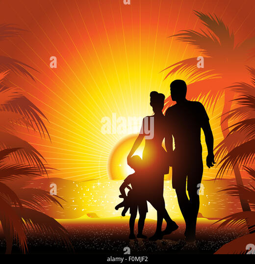 family silhouette on the beach with sunset - Stock Image