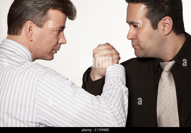 Two businessmen arm wrestling - Stock Image