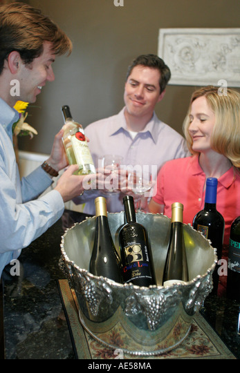 Leesburg Virginia West Market Street Serendipity on the Vine wine tasting bar bottles couple - Stock Image