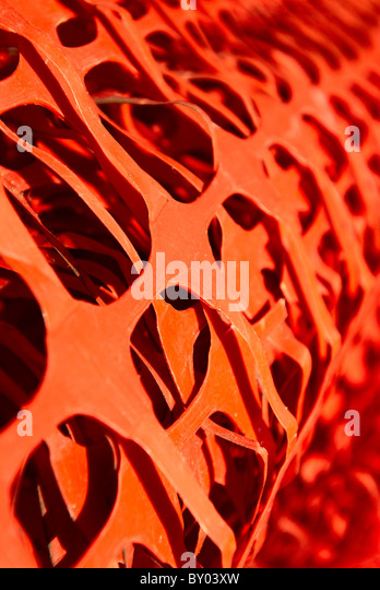 Roll of plastic fencing - Stock Image
