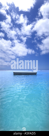 Swimming float in tropical sea with cloudy sky - Stock Image