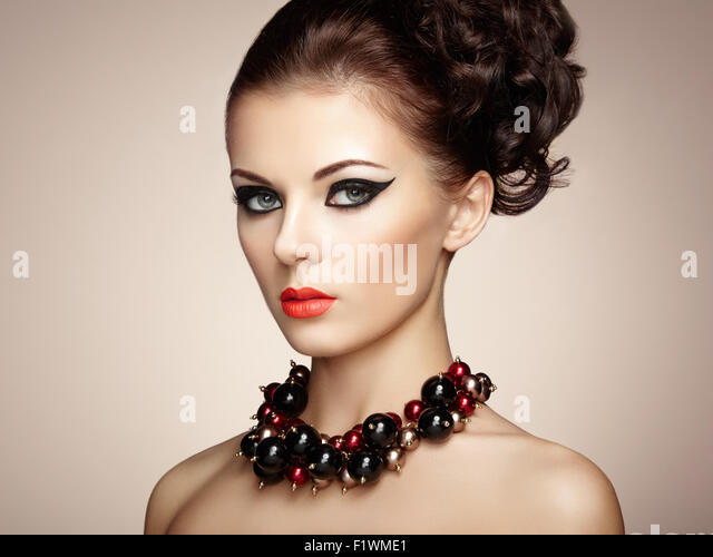 Portrait of beautiful sensual woman with elegant hairstyle.  Perfect makeup. Fashion photo - Stock Image