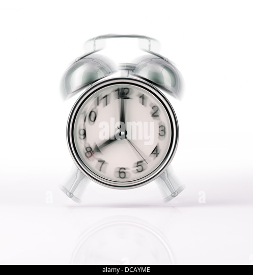 Classic Alarm clock chromed ringing, with movement effect. Front view on white background, with slight reflection - Stock Image