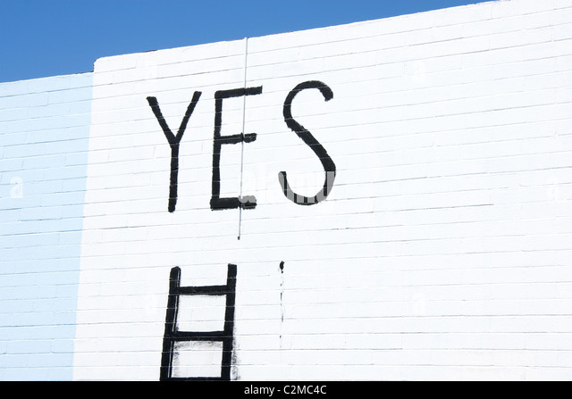 Word yes written on a wall - Stock-Bilder