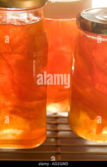 Jars of home made marmalade - Stock Image