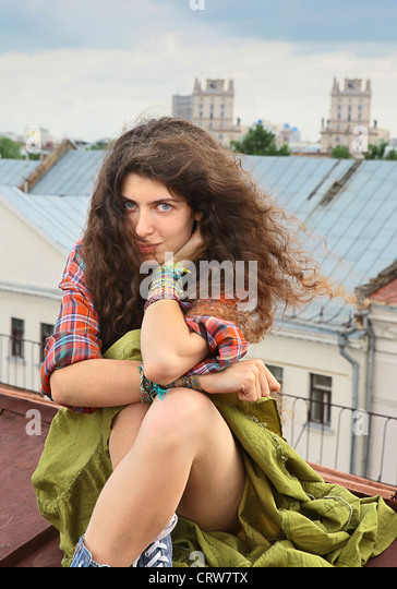 Girl on a roof - Stock Image