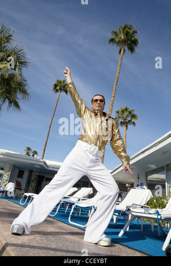 Low angle view of man impersonating Elvis Presley - Stock Image