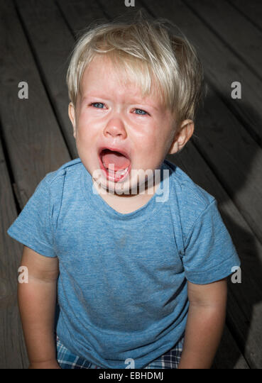 Young boy crying - Stock Image