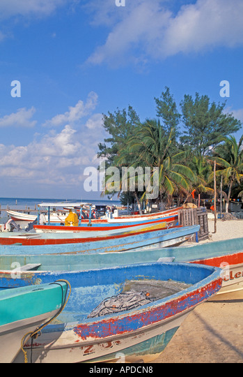 Mexico Isla Mujeres fishing boats on beach bright sunlight - Stock Image