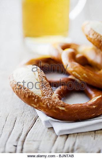 Several soft pretzels and glass of beer - Stock-Bilder