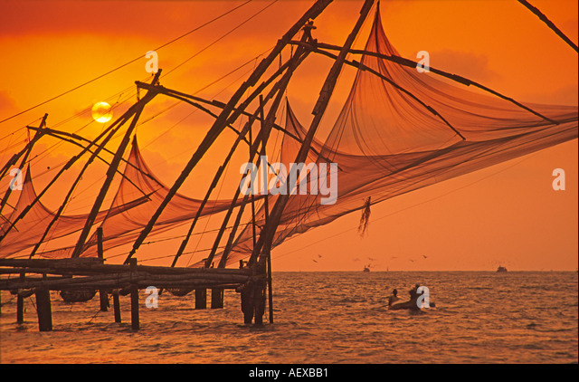India Kerala Cochin Chinese fishing nets at sunset - Stock Image