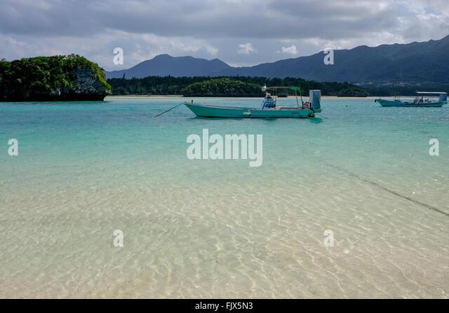 Boats Moored On Sea At Ishigaki - Stock Image