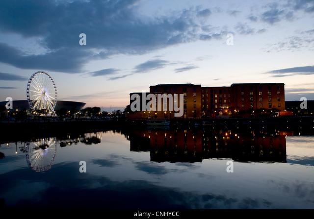 Sunset over waterfront towards Albert Dock, Liverpool, UK - Stock Image