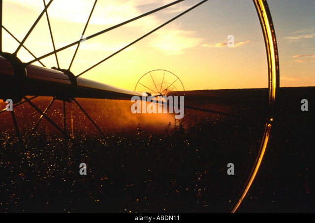 A graphic close up of an irrigation wheel during use - Stock Image