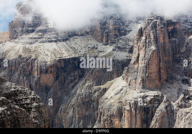 Cloud on the dramatic Sass Pordoi mountain in the Dolomites near Canazei, Trentino-Alto Adige, Italy - Stock Image