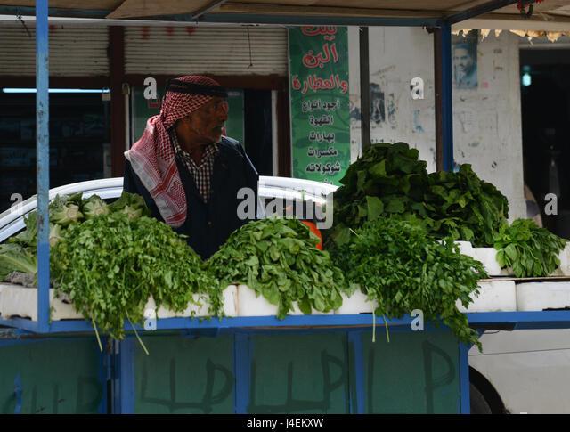A fresh herb vendor in Karameh, Jordan valley, Jordan. - Stock Image