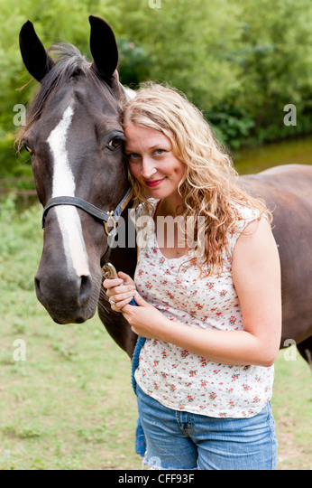 Blonde woman outside - Stock Image