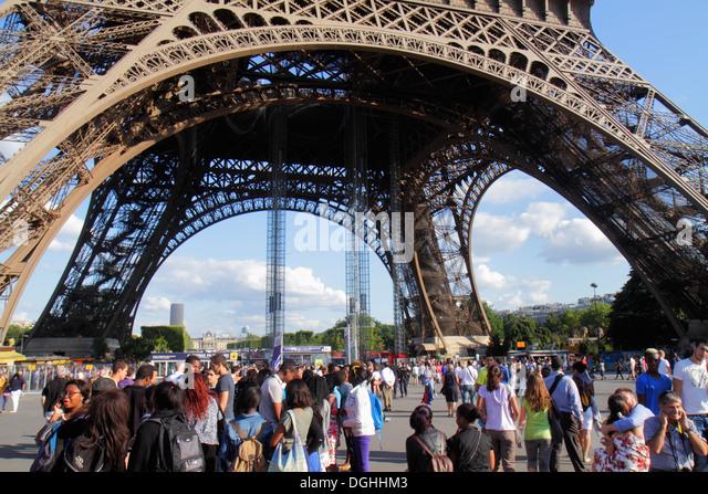 Paris France Europe French 7th arrondissement Eiffel Tower base crowds crowd legs pillars line queue - Stock Image