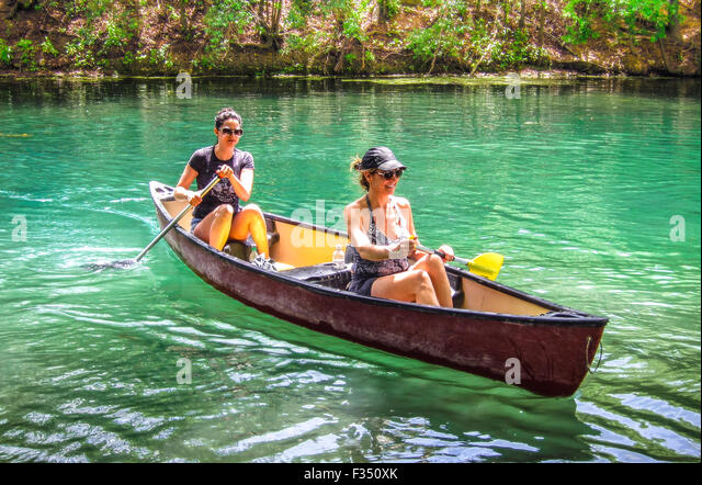 Canoeing on Barton Creek, a tributary that feeds the Colorado River as it flows through Texas Hill Country at Austin, - Stock Image
