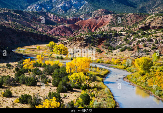 The Chama River flows through the vilage of Abiquiu in northern New Mexico and is near both Pedernal peak and Ghost - Stock Image
