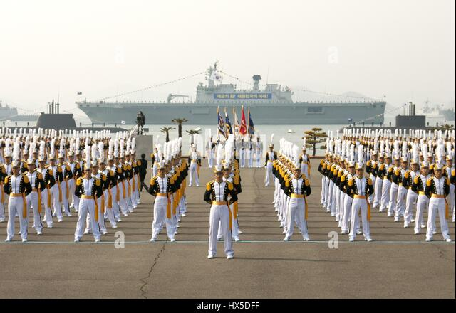 In long synchronized lines at the edge of water where ships and submarines float, Midshipmen at the Republic of - Stock Image