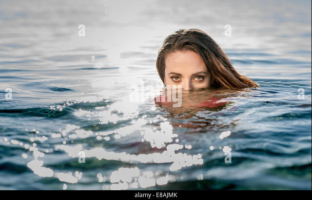 Portrait of young woman in swimming in sea, Castiadas, Sardinia, Italy - Stock Image