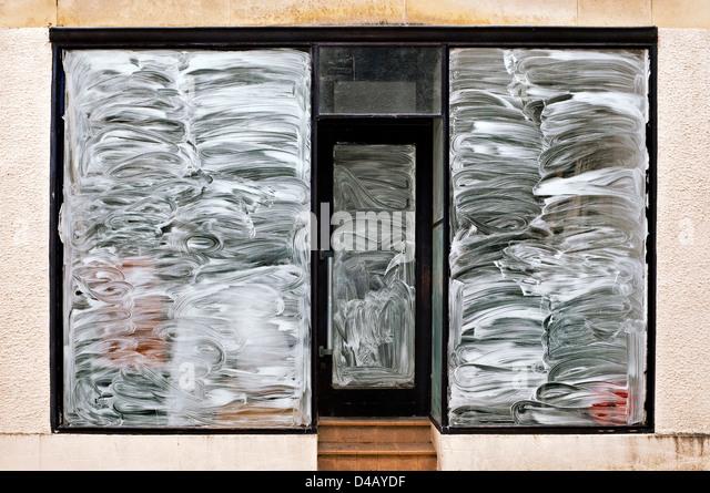 Whitewashed shop window - France. - Stock Image