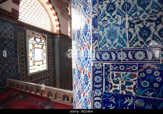 Exquisite Iznik tiles inside the Rustem Pasha Camil Ottoman Mosque Istanbul Turkey - Stock Image