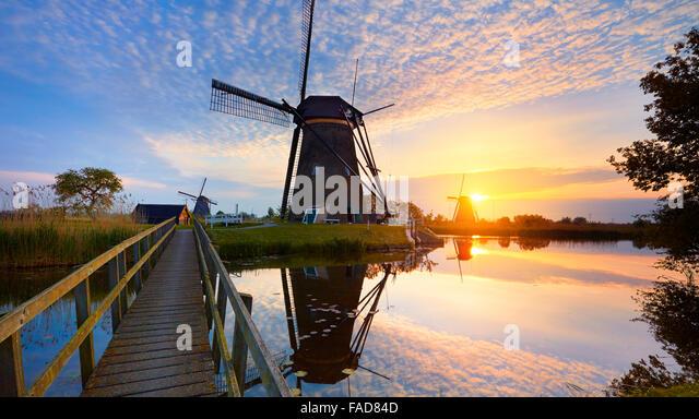 Kinderdijk windmills at sunset - Holland Netherlands - Stock Image