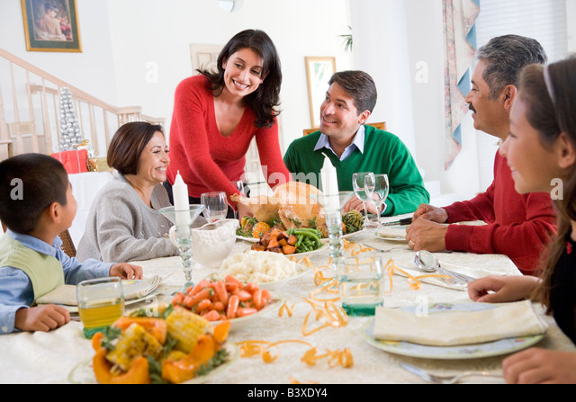 Family All Together At Christmas Dinner - Stock Image
